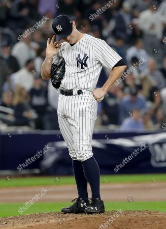 New York Yankees relief pitcher David Robertson reacts as he waits to be relieved during the seventh inning of Game 4 of baseball's American League Division Series against the Boston Red Sox, in New York