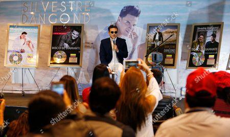 "Colombian singer Silvestre Dangond speaks during a press conference in Bogota, Colombia, . The star of vallenato received five diamond selling records on Tuesday, for ""Esto es vida"", ""Sigo invicto"", ""No me compares con nadie"", ""El original"" and ""Gente Valiente"