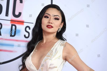 Tina Guo arrives at the American Music Awards, at the Microsoft Theater in Los Angeles