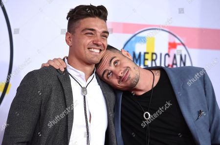 Stock Picture of Ben Higgins, Dean Michael Unglert. Ben Higgins, left, and Dean Michael Unglert arrive at the American Music Awards, at the Microsoft Theater in Los Angeles