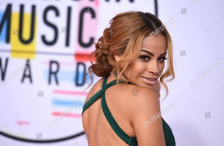 Charisse Mills arrives at the American Music Awards, at the Microsoft Theater in Los Angeles