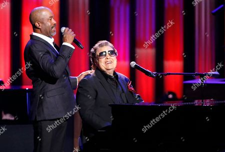 "Darius Rucker, Ronnie Milsap. Host Darius Rucker, left, introduces Ronnie Milsap during ""An Opry Salute to Ray Charles"" at the Grand Ole Opry House in Nashville, Tenn"