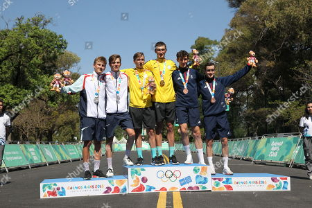 Medalists in the men's cycling combined race (L-R) of Luxembourg (silver) Nicolas Kess and Arthur Kluckers; Kazakhs, (gold) Yevgeniy Fedorov and Gleb Brussenskiy; and of Great Britain (bronze), Harry Birchill and Sean Flynn, pose at the podium after their competition of the Olympic Games of Youth 2018, in Buenos Aires, Argentina, 17 October 2018.