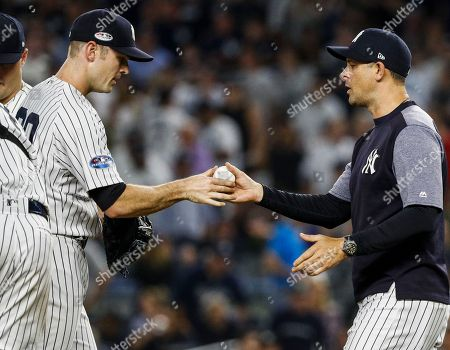 New York Yankees relief pitcher David Robertson (L) is pulled by New York Yankees manager Aaron Boone (R) in the seventh inning of the MLB American League Division Series baseball game four between the Boston Red Sox and the New York Yankees at Yankee Stadium in New York, New York, USA, 09 October 2018. The best-of-five series is tied 1-1 and the winner will go on to face either the Cleveland Indians or the Houston Astros in the American League Championship Series.