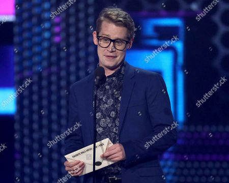 Macaulay Culkin presents the award for favorite male pop/rock artist at the American Music Awards, at the Microsoft Theater in Los Angeles