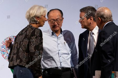 (L-R) International Monetary Fund (IMF) Managing Director Christine Lagarde, President of the World Bank Group Jim Yong Kim, Director General of the World Trade Organization (WTO), Roberto Azevedo and Secretary-General of the Organisation for Economic Co-operation and Development (OECD) Jose Angel Gurria converse during the Trade Conference introduction at the International Monitary Fund (IMF) and World Bank annual meeting in Nusadua, Bali, Indonesia, 10 October 2018. Bali is hosting the IMF-World Bank annual meeting from 08 to 14 October 2018.