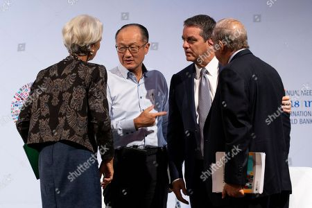 (L-R) International Monetary Fund (IMF) Managing Director Christine Lagarde, President of the World Bank Group Jim Yong Kim, Director General of the World Trade Organization (WTO), Roberto Azevedo and Secretary-General of the Organisation for Economic Co-operation and Development (OECD) Jose Angel Gurria converse during Trade Conference introduction at the International Monitary Fund (IMF) and World Bank annual meeting in Nusadua, Bali, Indonesia, 10 October 2018. Bali is hosting the IMF-World Bank annual meeting from 08 to 14 October 2018.