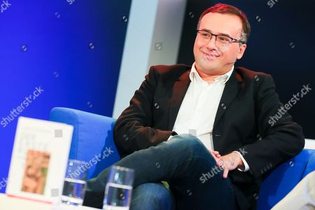 Stock Image of Georgian novelist Lasha Bugadze speaks at the authors' forum 'Blue Sofa' during the book fair 'Frankfurter Buchmesse 2018', in Frankfurt am Main, Germany, 10 October 2018. The 70th edition of the international Frankfurt Book Fair, described as the 'world's most important fair for the print and digital content business' runs from 10 to 14 October and gathers authors, writers and celebrities from all over the world. This year's Guest of Honour country is Georgia.