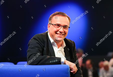 Stock Photo of Georgian novelist Lasha Bugadze speaks at the authors' forum 'Blue Sofa' during the book fair 'Frankfurter Buchmesse 2018', in Frankfurt am Main, Germany, 10 October 2018. The 70th edition of the international Frankfurt Book Fair, described as the 'world's most important fair for the print and digital content business' runs from 10 to 14 October and gathers authors, writers and celebrities from all over the world. This year's Guest of Honour country is Georgia.