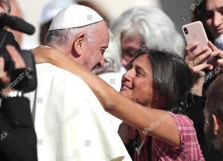 Pope Francis with Italian showgirl Rosita Celentano, daughter of Italian actor, director and singer Adriano Celentano, during the weekly general audience in Saint Peter's Square, Vatican City, 10 October 2018.