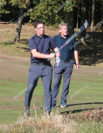 Robbie Fowler, hits to the first green watched by Kenny Dalglish