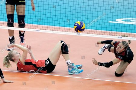 Jennifer Geerties (L) and Lenka Durr (R) of Germany in action during the FIVB Women's World Championship second round Pool E match between Germany and Puerto Rico in Nagoya, central Japan, 10 October 2018.