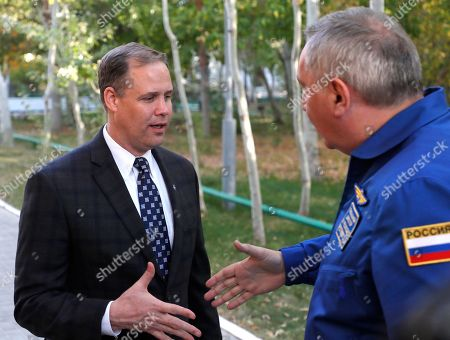 Director General of the Russia state corporation Roscosmos Dmitry Rogozin, right, shakes hands with Administrator of the National Aeronautics and Space Administration (NASA) Jim Bridenstine in Russian leased Baikonur cosmodrome, Kazakhstan