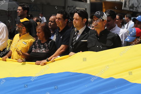 Stock Picture of Venezuelan Opposition leader Henrique Capriles (R) is seen with hundred of people during a walk to accompany the funeral procession of the late Venezuelan Councilman Fernando Alban, in Caracas, Venezuela, on 10 October 2018. The funeral procession begin with a walk of 12 kilometers before the burial of Alban, who committed suicide according the Prosecution, although the opposition claim it was a murder.