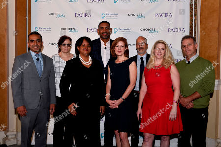 """L-R) Paul Sethi, M.D., Kimberly Robbins, Regina Benjamin, M.D., Grant Hill, Marcia Lee Taylor, Fred Muench, Ph.D., Cecelia """"Cece"""" Spitznas, Ph.D., and Jim Moser at the Summit for Solutions, an event held to address the opioid epidemic, hosted by the Partnership for Drug-Free Kids and Pacira Pharmaceuticals, in Washington"""