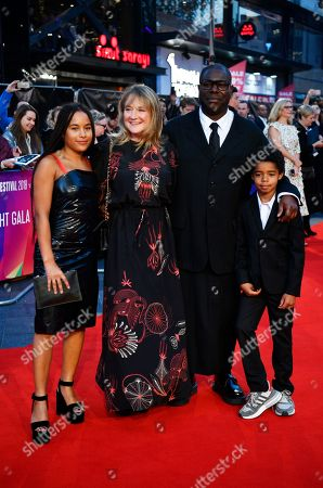 British artist and filmmaker Steve McQueen (2-R) arrives with partner Bianca Stigter and their children Alex (L) and Dexter (R) at the Opening Night Gala presentation of his film 'Widows' at the BFI London Film Festival 2018, in London, Britain, 10 October 2018. The festival runs from the 10 to 21 October.