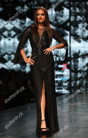Bollywood actress Sonakshi Sinha presents a creation by Indian designers Rohit Gandhi and Rahul Khanna during the Lotus Make-up India Fashion Week Spring Summer 2019 in New Delhi, India, 10 October 2018. The event runs from 10 to 13 October.