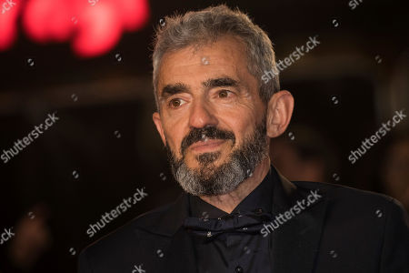 Daniel Battsek poses for photographers upon arrival at the premiere of the film 'Widows' showing as part of the opening gala of the BFI London Film Festival in London