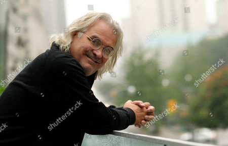 """This photo shows filmmaker Paul Greengrass posing for a portrait at the Shangri-La Hotel to promote his film """"22 July,"""" during the Toronto International Film Festival in Toronto"""