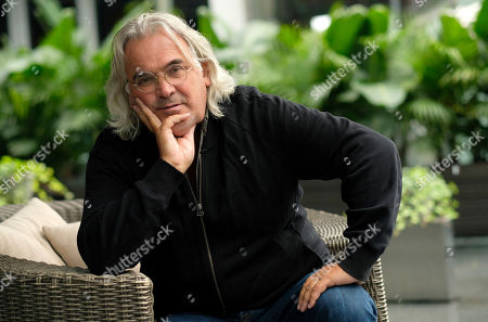 "This photo shows filmmaker Paul Greengrass posing for a portrait at the Shangri-La Hotel to promote his film ""22 July,"" during the Toronto International Film Festival in Toronto"