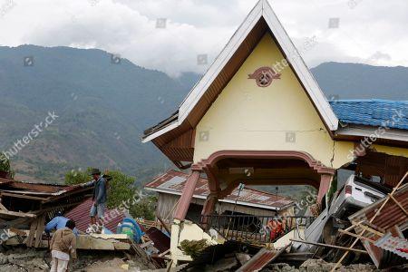 Earthquake tsunami strike Indonesia Stock Photos (Exclusive