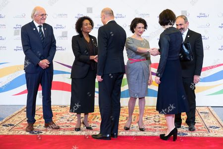 Swiss Federal President Alain Berset (3-L) and his wife Muriel Zeender Berset (2-R) are welcomed by Armenian Prime Minister Nikol Pachinian (R) and his wife Anna Hakobyan (3-R), Michaelle Jean (2-L), Secretary General of the International Organization of la Francophonie and her husband Jean-Daniel Lafond (L) during the official reception at the Francophonie Summit 2018 in Yerevan, Armenia, 11 October 2018.