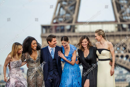 YEARENDER JULY 2018 US actor/cast member Tom Cruise (3-L) poses with actresses/cast members Michelle Monaghan (3-R), Angela Basset (2-L), Alix Benezech (L), Rebecca Ferguson (2-R) and Vanessa Kirby (R) in front of the Eiffel Tower during the global premiere of 'Mission: Impossible - Fallout' in Paris, France, 12 July 2018.