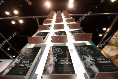 The book 'Murder of the Impossible' (Mord am Unmoeglichen) of Reinhold Andreas Messner, Italian extreme mountaineer, book author and former regional politician are seen at the Piper pavilion during the book fair 'Frankfurter Buchmesse 2018' in Frankfurt am Main, Germany, 11 October 2018. The 70th edition of the international Frankfurt Book Fair, described as the 'world's most important fair for the print and digital content business' runs from 10 to 14 October and gathers authors, writers and celebrities from all over the world. This year's Guest of Honour country is Georgia.