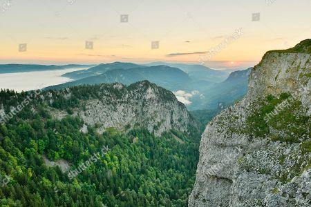 Stock Photo of Creux du Van, rock face at sunrise, Le Soliat, canton of Jura, Switzerland