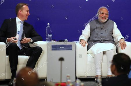 Borge Brende, President and Member of the Managing Board of the World Economic Forum, left, talks with Indian Prime Minister Narendra Modi at the launch of Centre for the Fourth Industrial Revolution India in New Delhi, India, . Modi on Thursday launched the new Centre for the Fourth Industrial Revolution India, opened by the World Economic Forum, the Centre for the Fourth Industrial Revolution India will work in collaboration with the government on a national level to co-design new policy frameworks and protocols for emerging technology alongside leaders from business, academia, start-ups and international organizations, according to a press release