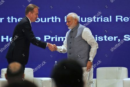 Borge Brende, President and Member of the Managing Board of the World Economic Forum, left, shakes hand with Indian Prime Minister Narendra Modi at the launch of Centre for the Fourth Industrial Revolution India in New Delhi, India, . Modi on Thursday launched the new Centre for the Fourth Industrial Revolution India, opened by the World Economic Forum, the Centre for the Fourth Industrial Revolution India will work in collaboration with the government on a national level to co-design new policy frameworks and protocols for emerging technology alongside leaders from business, academia, start-ups and international organizations, according to a press release