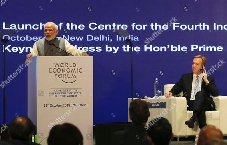 Borge Brende, President and Member of the Managing Board of the World Economic Forum, right, listens as Indian Prime Minister Narendra Modi speaks at the launch of Centre for the Fourth Industrial Revolution India in New Delhi, India, . The Centre for the Fourth Industrial Revolution India, opened by the World Economic Forum, will work in collaboration with the government on a national level to co-design new policy frameworks and protocols for emerging technology alongside leaders from business, academia, start-ups and international organizations, according to a press release