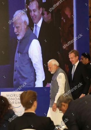 Borge Brende, President and Member of the Managing Board of the World Economic Forum, right and Indian Prime Minister Narendra Modi arrive at the launch of Centre for the Fourth Industrial Revolution India in New Delhi, India, . The Centre for the Fourth Industrial Revolution India, opened by the World Economic Forum, will work in collaboration with the government on a national level to co-design new policy frameworks and protocols for emerging technology alongside leaders from business, academia, start-ups and international organizations, according to a press release