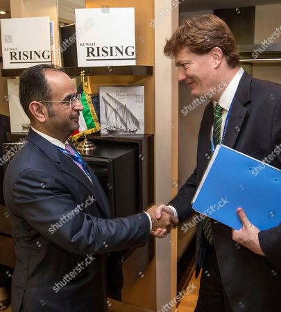 The Kuwaiti Minister of Finance Dr. Nayef Al-Hajraf, left, shakes hands with Sir Danny Alexander, Vice President and Corporate Secretary of the Asian Infrastructure Investment Bank ahead of a meeting between their respective delegations during the 2018 IMF and World Bank Group Annual Meetings, at the Westin Hotel, Nusa Dua, Bali, Indonesia