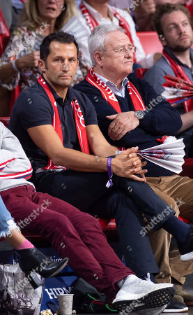Bayern Munich's director of sport Hasan Salihamidzic (L) and the former chairman of the board of directors of Volkswagen AG, Martin Winterkorn, during the Euroleague basketball match between FC Bayern Munich and Anadolu Efes Istanbul in Munich, Germany, 11 October 2018.
