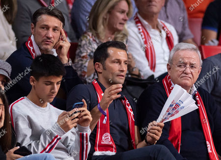 Bayern Munich's director of sport Hasan Salihamidzic (C, down) the former chairman of the board of directors of Volkswagen AG, Martin Winterkorn (R), and Bayern Munich's head coach Niko Kovac (L, up) during the Euroleague basketball match between FC Bayern Munich and Anadolu Efes Istanbul in Munich, Germany, 11 October 2018.