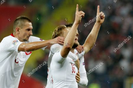 Teammates celebrate with Poland's Jakub Blaszczykowski, center, after he scored his side's second goal during the UEFA Nations League soccer match between Poland and Portugal at the Silesian Stadium Chorzow, Poland