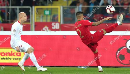 Poland's Rafal Kurzawa (L) and Portugal's Joao Cancelo (R) in action during the UEFA Nations League soccer match between Poland and Portugal, in Chorzow, Poland, 11 October 2018.