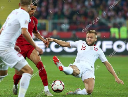 Poland's Jakub Blaszczykowski (R) and Portugal's Joao Cancelo (C) in action during the UEFA Nations League soccer match between Poland and Portugal, in Chorzow, Poland, 11 October 2018.