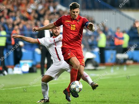 Montenegro's Stevan Jovetic, front, duels for the ball with Serbia's Andrija Zivkovic during the UEFA Nations League soccer match between Montenegro and Serbia at the City stadium in Podgorica, Montenegro