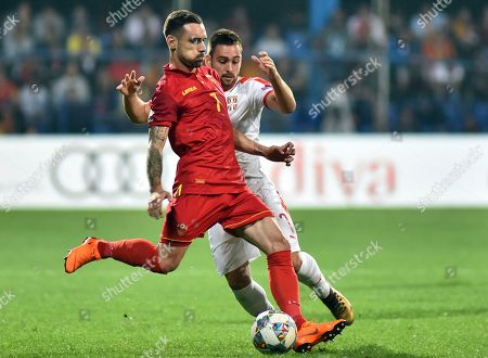 Montenegro's Marko Vesovic, front, duels for the ball with Serbia's Andrija Zivkovic during the UEFA Nations League soccer match between Montenegro and Serbia at the City stadium in Podgorica, Montenegro