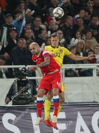Stock Photo of Konstantin Rausch of Russia (L) in action against John Guidetti of Sweden (R) during the UEFA Nations League soccer match between Russia and Sweden, in Kaliningrad, Russia, 11 October 2018.