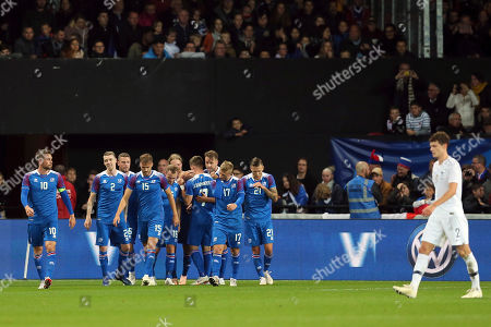 Iceland's players celebrate their second goal scored by Kari Arnason, unseen, during a friendly soccer match between France and Iceland, in Guingamp, western France
