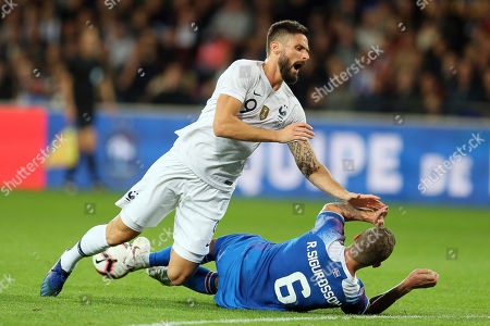 France's Olivier Giroud, left, and Iceland's Ragnar Sigurdsson, challenge for the ball during a friendly soccer match between France and Iceland, in Guingamp, western France