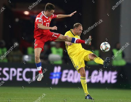 Andreas Granqvist, Aleksandr Golovin. Russia's Aleksandr Golovin, left, fights for the ball with Sweden Andreas Granqvist during the UEFA Nations League soccer match between Russia and Sweden at the Kaliningrad Stadium in Kaliningrad, Russia