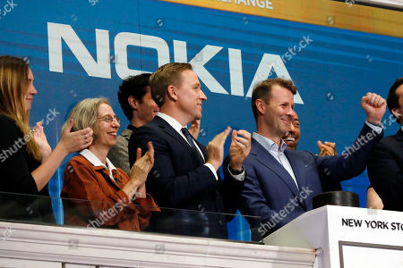 Nokia's Chairman Risto Siilasmaa, right, is applauded as he rings the New York Stock Exchange closing bell