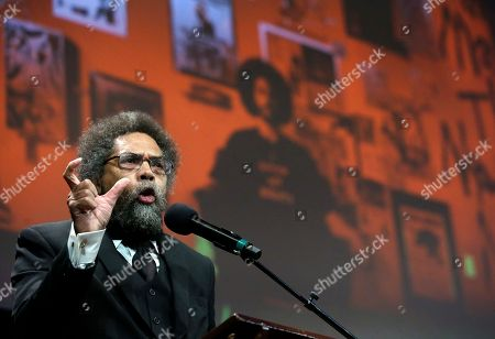 Harvard professor and philosopher Cornel West, left, address an audience in front of a projected image of former NFL football quarterback Colin Kaepernick, before presenting Kaepernick with the W.E.B. Du Bois Medal during ceremonies, at Harvard University, in Cambridge, Mass. Kaepernick is among eight recipients of Harvard University's W.E.B. Du Bois Medals in 2018. Harvard has awarded the medal since 2000 to people whose work has contributed to African and African-American culture