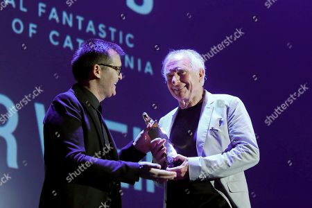 Australian director Peter Weir (R) receives the Honourable Big Award from the festival's director Angel Sala (L) during the Sitges' Fantastic Cinema International Festival gala held in Sitges, Barcelona, Spain, 11 October 2018.