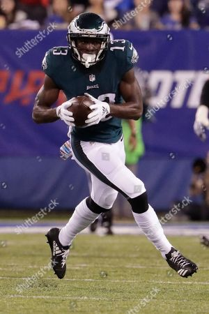 Philadelphia Eagles wide receiver Nelson Agholor (13) runs away form New York Giants' Kerry Wynn (72) during the first half of an NFL football game, in East Rutherford, N.J