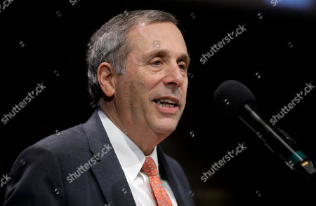 Stock Photo of Harvard University President Lawrence Bacow addresses an audience during W.E.B. Du Bois Medal ceremonies, at Harvard University, in Cambridge, Mass. Former NFL football quarterback Colin Kaepernick is among eight recipients of Harvard University's W.E.B. Du Bois Medals in 2018. Harvard has awarded the medal since 2000 to people whose work has contributed to African and African-American culture